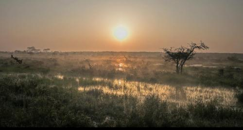 Sun rising over the Mugie dam