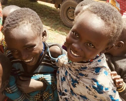 Two smiling faces at an outreach clinic